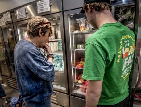 Volunteers helping people select food